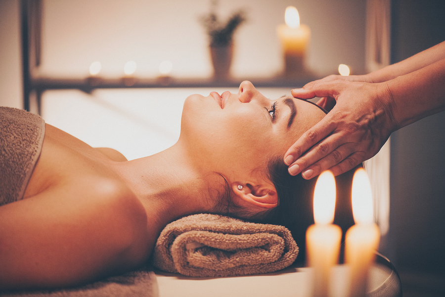 Spa woman Massage. Face Massage in beauty spa salon. Female enjoying relaxing body and facial massag: Spa woman Massage. Face Massage in beauty spa salon. Female enjoying relaxing body and facial massage in spa center. Body care, skin care, wellness, beauty treatment